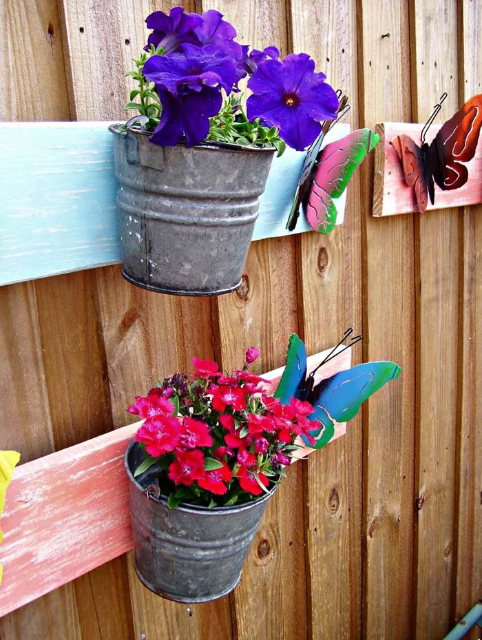 Bright Painted Butterflies on a Board with Pails #repurposedplanter #repurposedcontainer #decorhomeideas