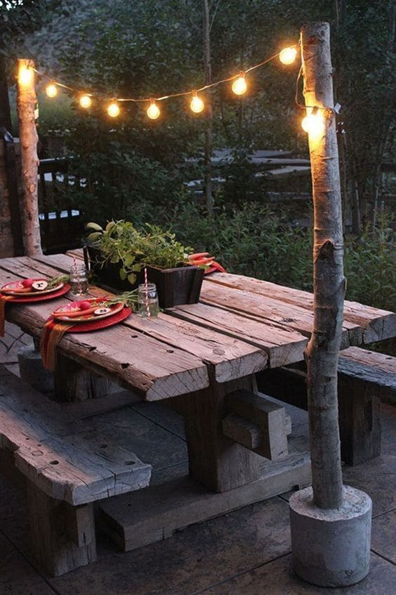 Cottage Backyard with Log Table and Benches #backyard #outdoorspaces #decorhomeideas