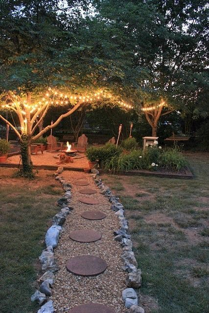 Cottage Backyard with Stone Garden Path and String Lights #backyard #outdoorspaces #decorhomeideas