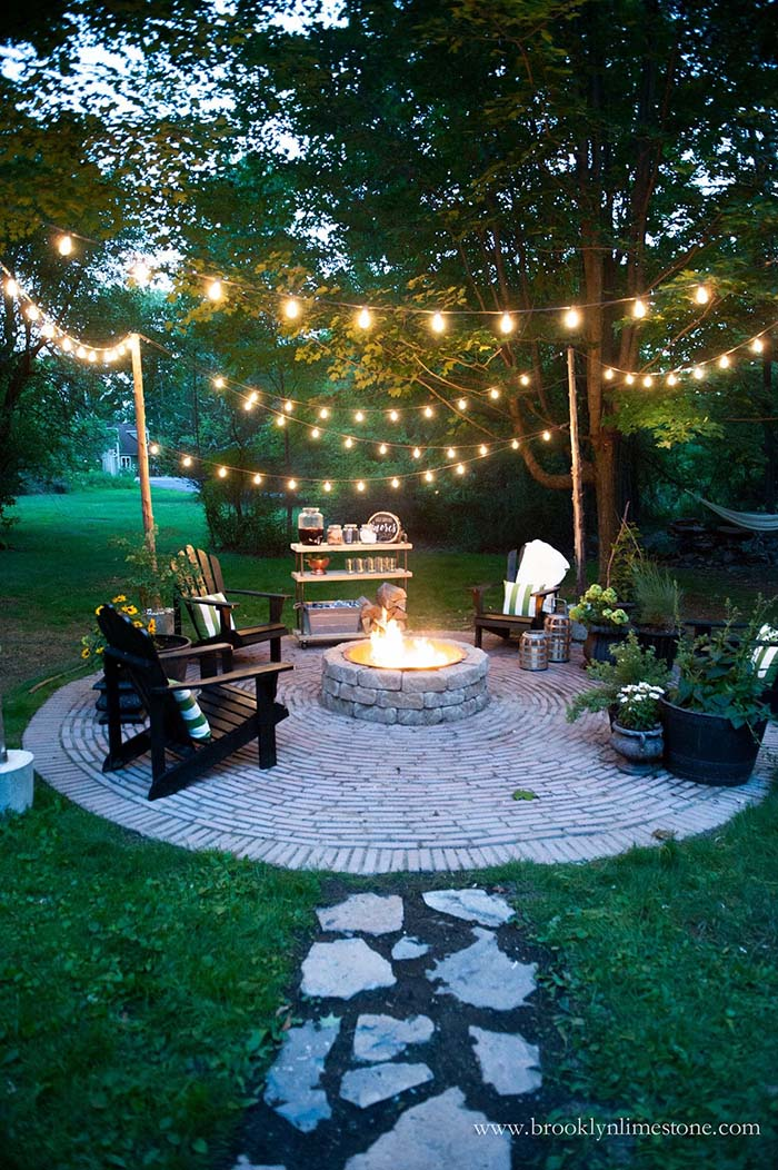 Cottage Backyard with String Lights and Stone Fire Pit #backyard #outdoorspaces #decorhomeideas