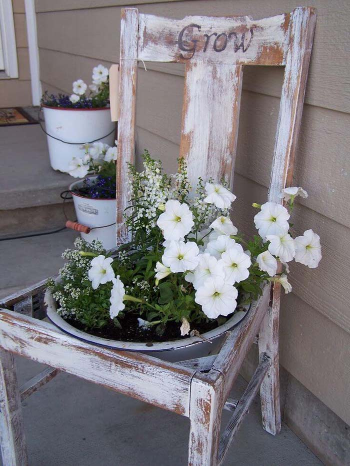 Distressed Chair with Petunias and Lettering #repurposedplanter #repurposedcontainer #decorhomeideas
