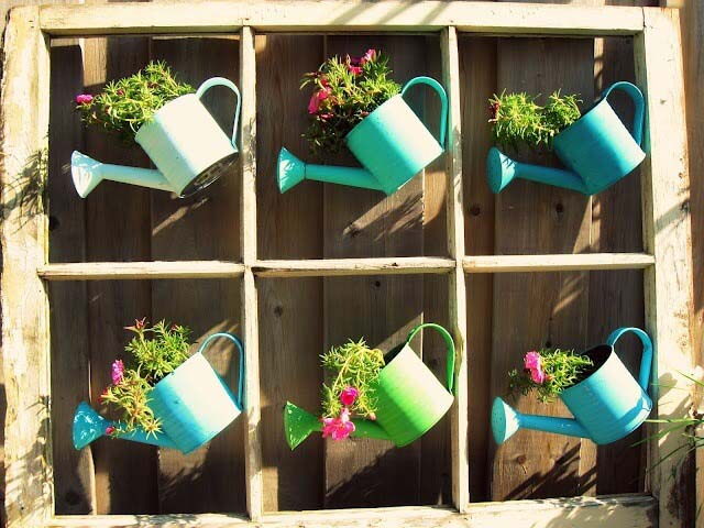 Whimsical Painted Watering Cans with Flowers #repurposedplanter #repurposedcontainer #decorhomeideas