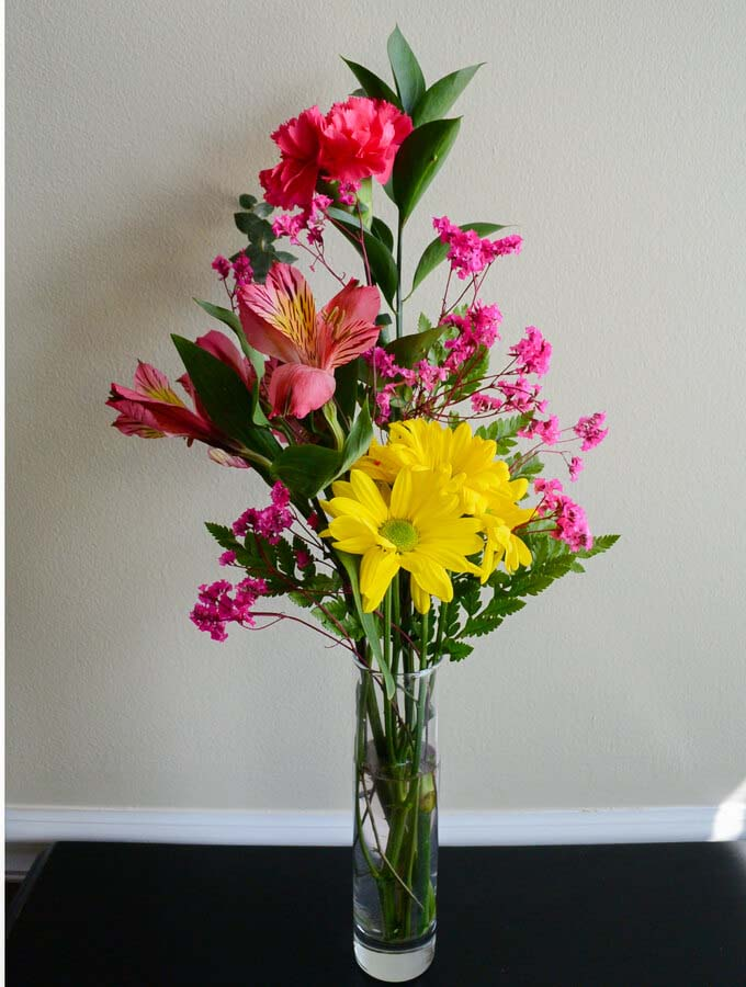 Bold and Bright Yellow and Pink Arrangement #flowerarrangementsideas #flowerarrangement #decorhomeideas