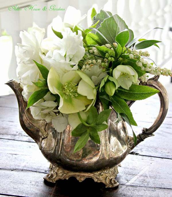 Silver Teapot with Green and White Arrangement #flowerarrangementsideas #flowerarrangement #decorhomeideas