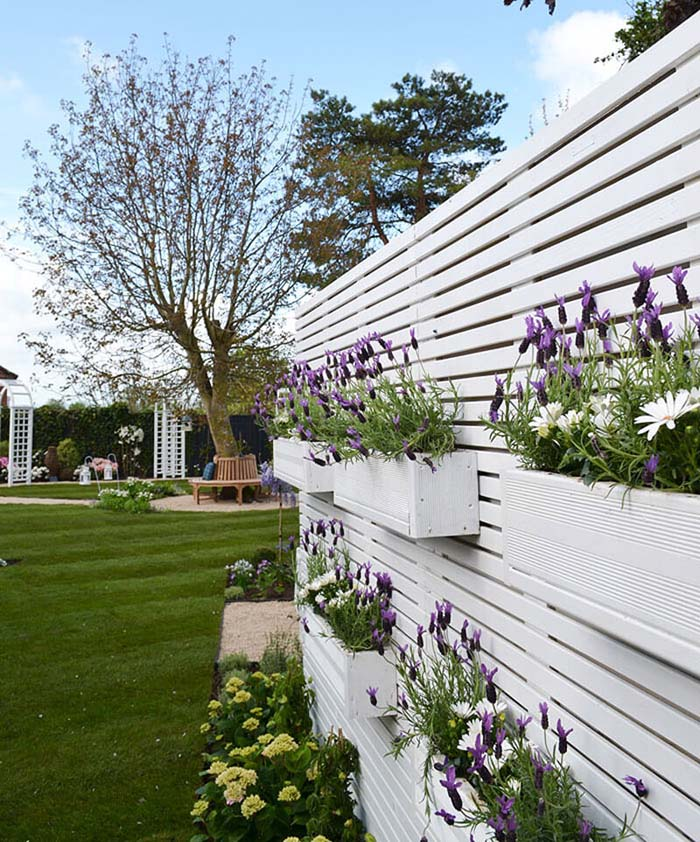 Stacked Window Boxes on a White Fence #gardenfencedecoration #decorhomeideas