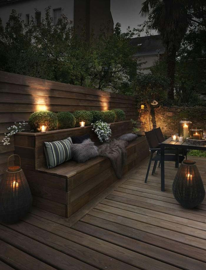 Upscale Outdoor Seating Bench Lit by Candles #backyardlightingideas #decorhomeideas