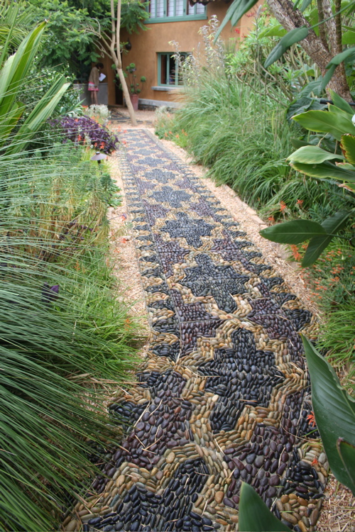 Authentic Black And Brown Stenciled Walkway With Stones