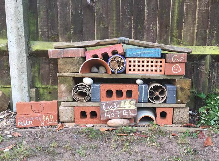 A Bug Hotel with Natural Materials and Recyclables #oldbrickideas #decorhomeideas