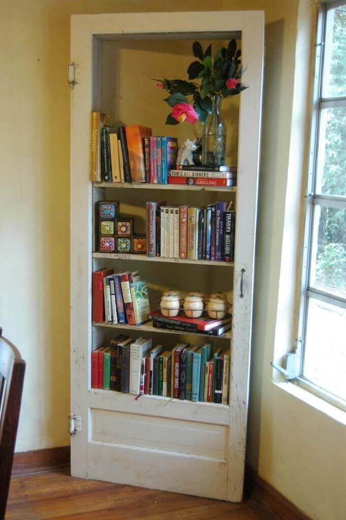 Book Shelves from Door and Reclaimed Wood #repurpose #olddoors #decorhomeideas