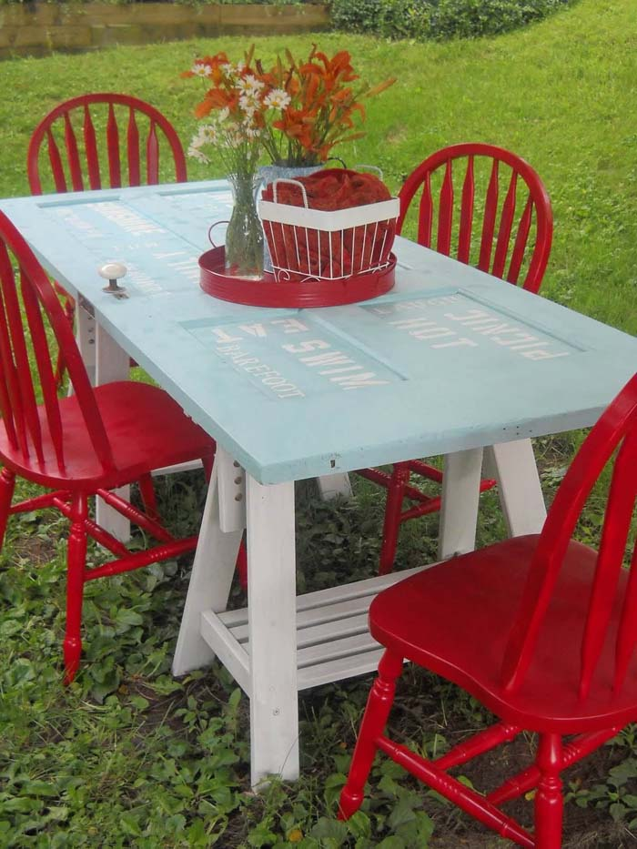 Outdoor Table DIY with Stenciling Detail #repurpose #olddoors #decorhomeideas