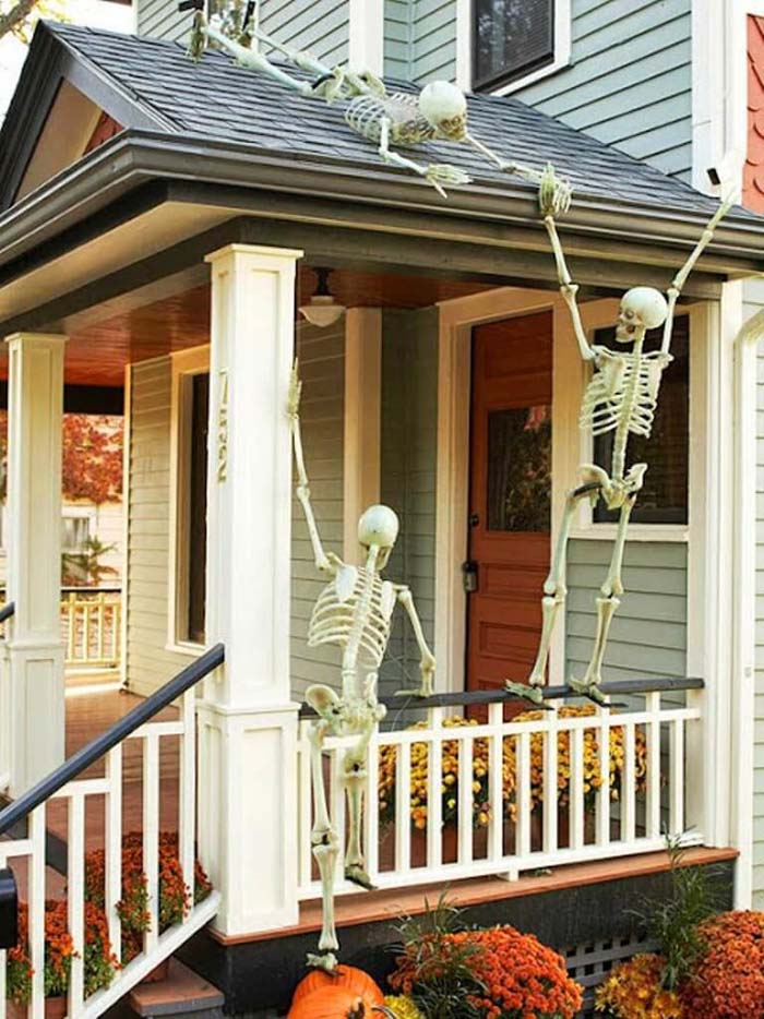 48. Skeletons on the Roof #frontporch #halloween #decorhomeideas
