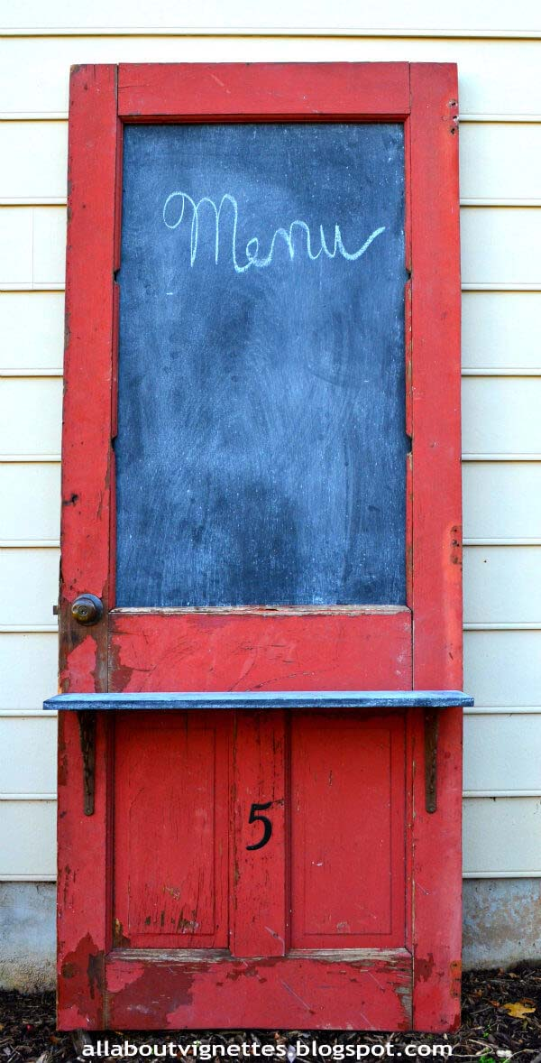 Upcycled Door with Chalkboard and Shelf #repurpose #olddoors #decorhomeideas